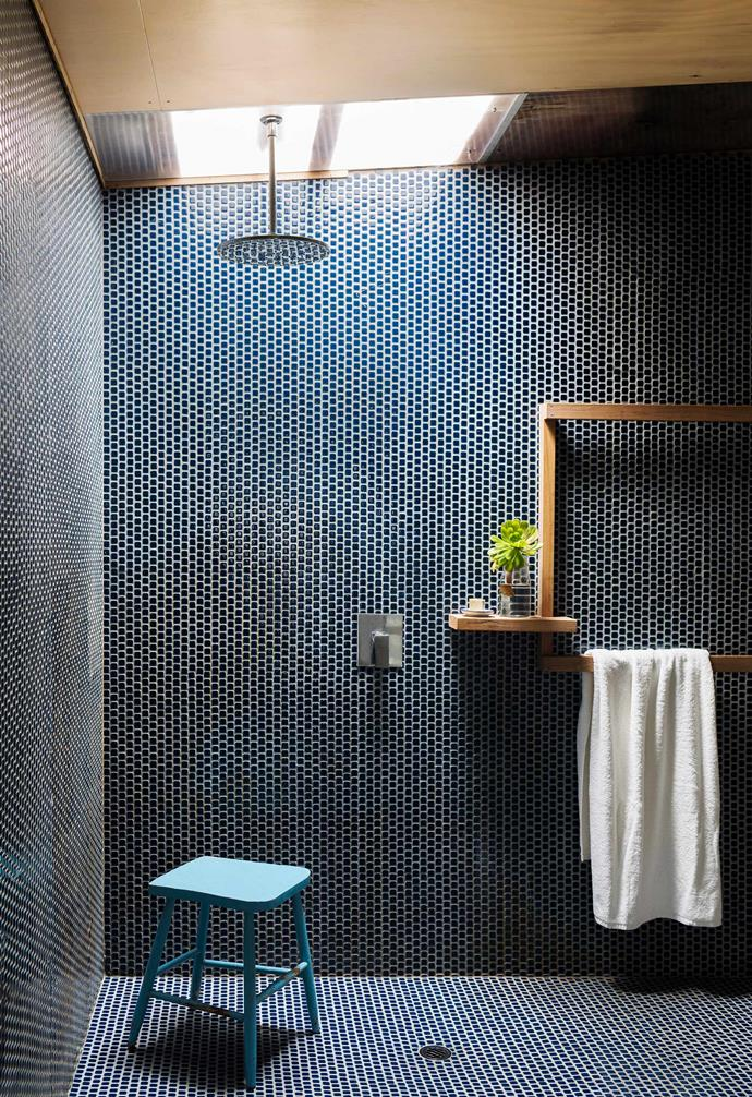 **Welcome surprise** Sometimes it pays to think on your feet. In the case of this bathroom, the owner used tiles that were left over from their newly built pool — a beautiful and cost-effective solution.