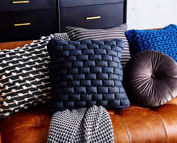 Use your cushions to add pops of colour to your living room. *Photo: Andrew Finlayson / bauersyndication.com.au*