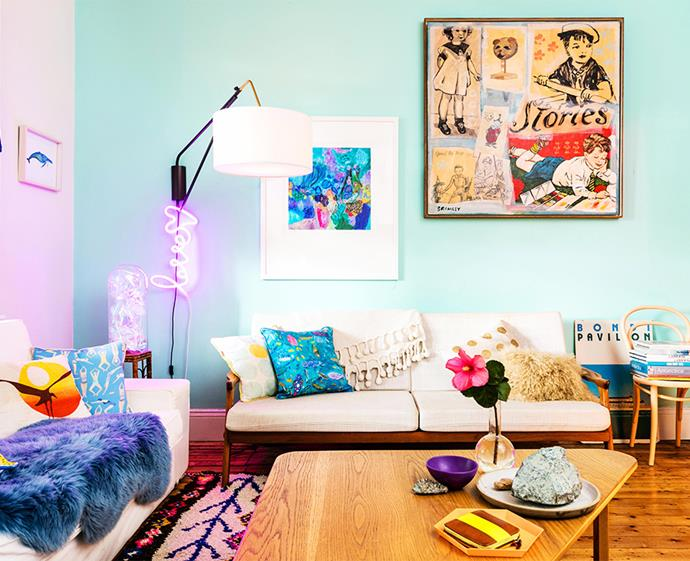We love the vibrancy this aqua blue feature wall adds to this eclectic space. *Photo: Jacqui Turk / bauersyndication.com.au*