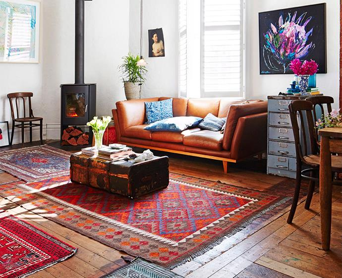 Dress your space up or tone it down with a floor rug (or three!), seen here accentuating the subtle colour pops throughout the room. Photo: Armelle Habib / bauersyndication.com.au