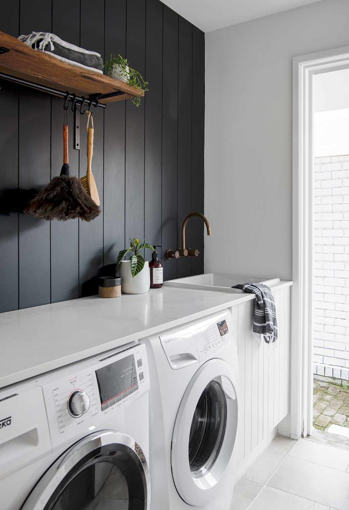 **Laundry** Caesarstone Calacatta Nuvo is used on the bench.