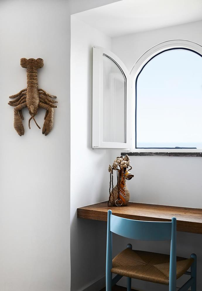 A desk custom-built by local joiners makes the most of a window in one of the three bedrooms. This nook is decorated with a woven raffia vase and lobster from Eco Capri. Hans Wegner 'CH36' chair.