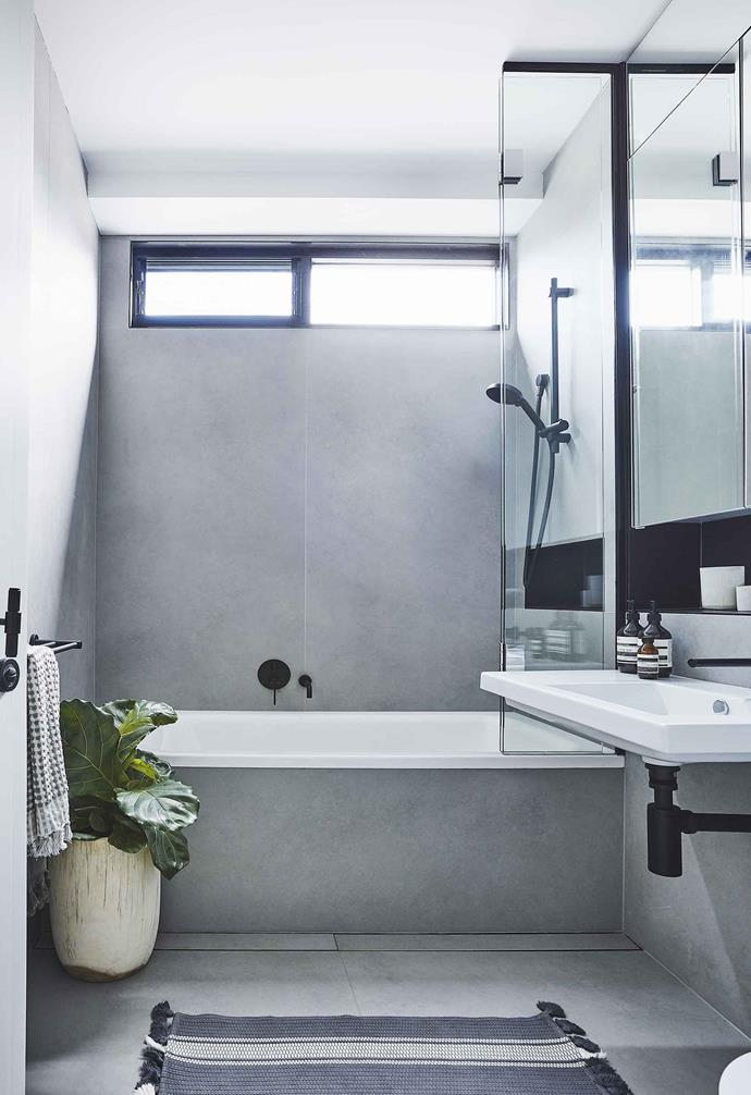 "Muted grey tones give the bathroom in this [Scandi-noir home](https://www.homestolove.com.au/scandi-noir-house-20344|target=""_blank"") a relaxed aesthetic."