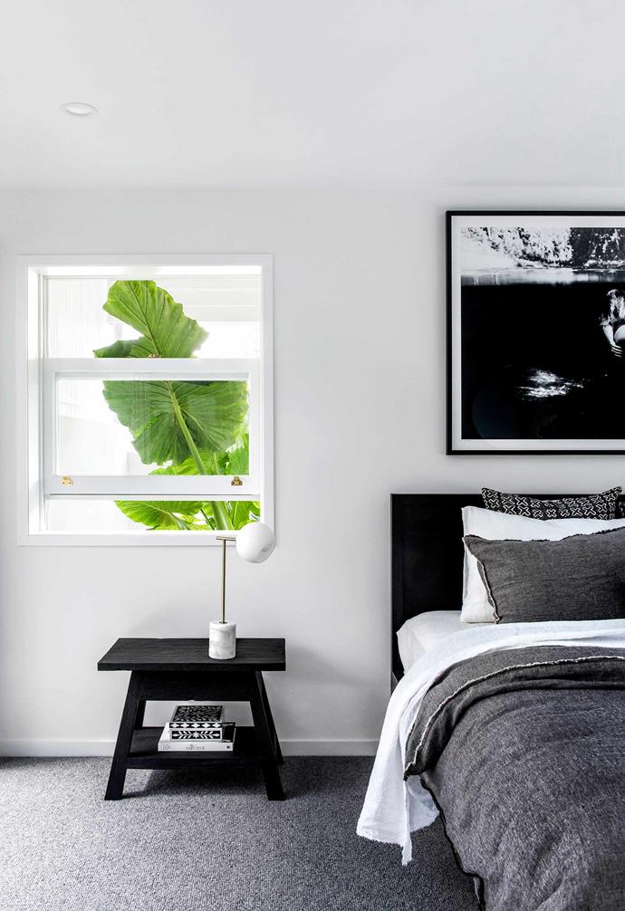 "**Main bedroom** Garden greenery in the window and adjacent courtyard brighten the black and white scheme. Lamp, [CLO Studios](https://clostudios.com.au/|target=""_blank""
