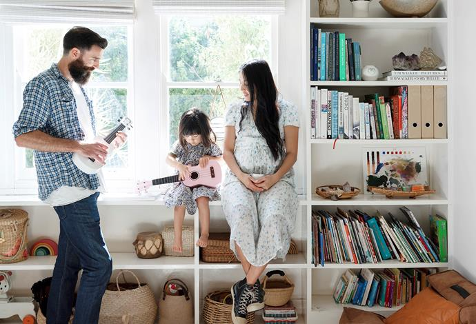 """It appears Rafa has inherited her parents' creativity. The couple turned this open shelving in the dining space into a library where art tomes and children's books are displayed beside woven baskets, which Dee says """"are great for everything, but mainly used for storage""""."""