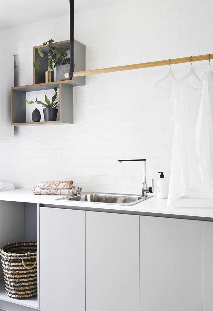 "A clever hanging rail helps keep drying clothes in order in the laundry of this [Palm Springs-inspired home](https://www.homestolove.com.au/palm-springs-house-coorparoo-19769|target=""_blank"")."