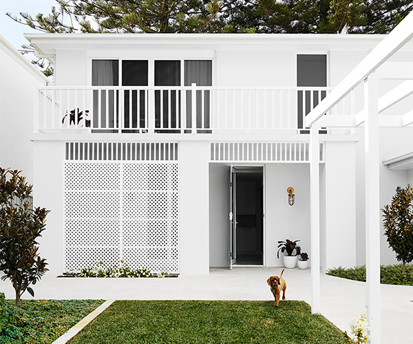 A white beachfront home with coastal style