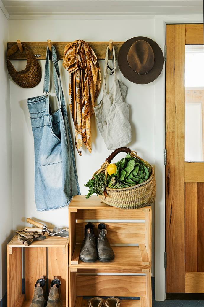 Gardening essentials are stored at the entrance. Harriet uses a basket bought years ago from Rigby's Homewares to collect vegetables.