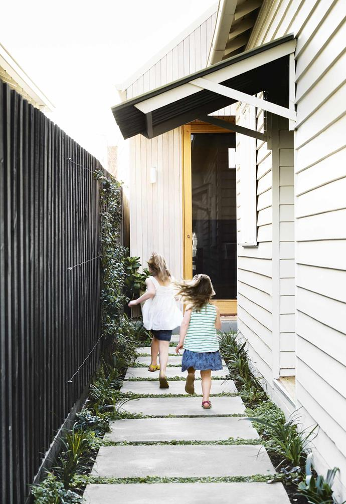 "Thanks to lightweight materials, including [exterior timber cladding](https://www.homestolove.com.au/wall-cladding-ideas-16125|target=""_blank""), the build took a speedy six months. ""We love the term 'radically conservative',"" says Monique of the exterior. ""We embellish the original detailing of the house until it becomes radical again and takes on a life of its own. New and old are in conversation with each other – original painted horizontal weatherboards with new milky vertical timbers.""<br><br>**Exterior** Shiplap cladding from [Radial Timber Sales](https://radialtimbers.com.au/