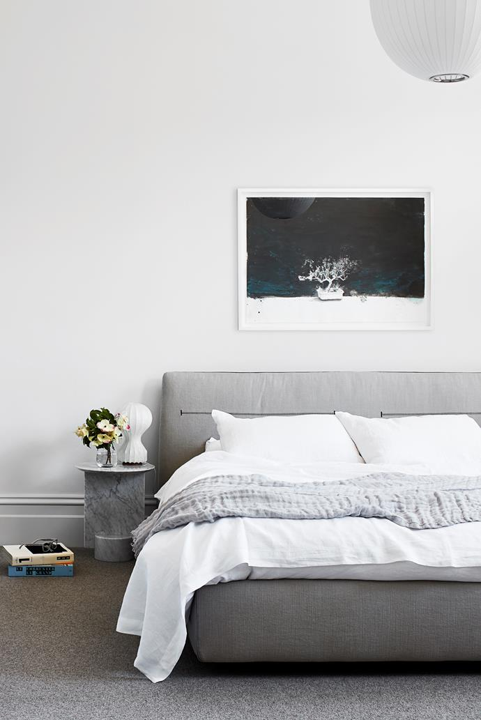 An artwork by Kwong Man Chun from Niagara Galleries hangs over the 'Jacqueline' bed from Poliform with linen from Bedouin Societe in the main bedroom. George Nelson 'Apple' pendant light from Luke Furniture. Castiglioni 'Gatto' lamp from Euroluce. Ligne Roset 'My Dear Sofa End Table' from Domo.