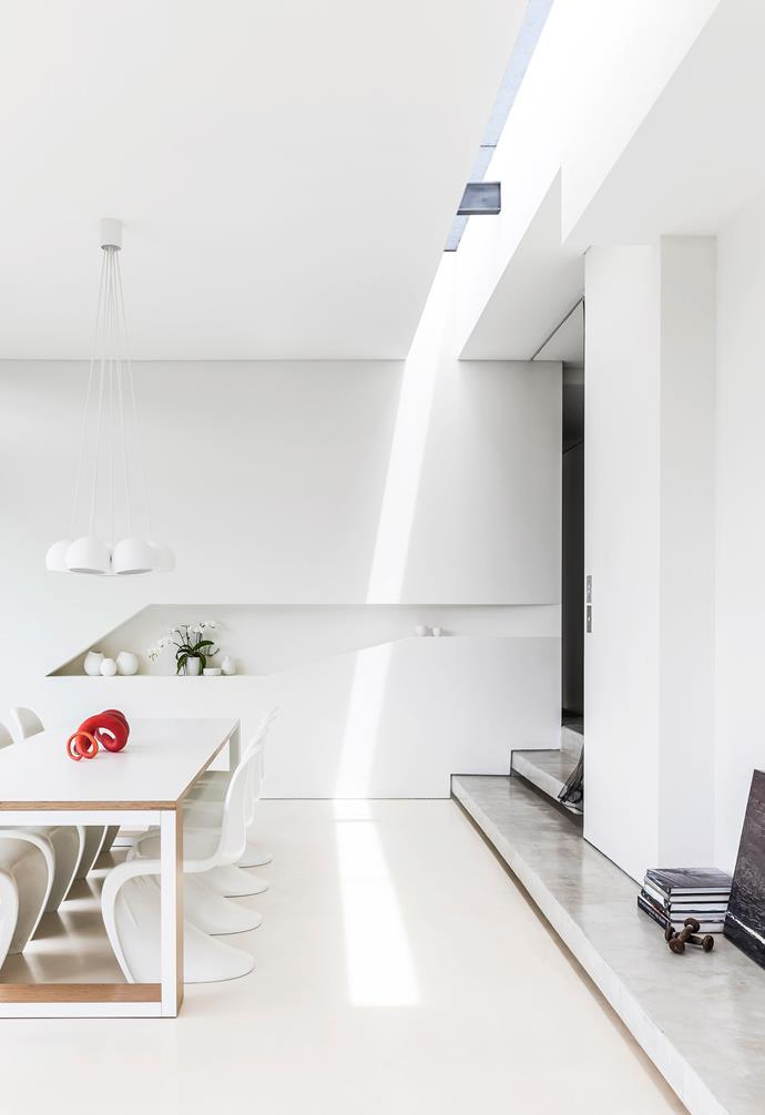 """**Dining** Suspended above a Koskela 'Maudan' table and Panton chairs from [Space](https://www.spacefurniture.com.au/