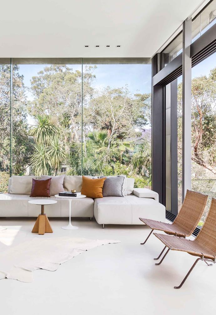 """**Living** Surrounded by nature courtesy of barely there windows, this space is furnished with iconic pieces. Moroso 'Lowland' leather sofa, [Hub Furniture](http://www.hubfurniture.com.au/