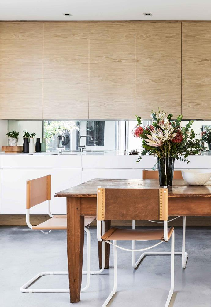 """**Kitchen/casual dining** """"Everything is integrated and hidden away so there's plenty of work space and it's easy to keep things clean and uncluttered,"""" says Kerry of her kitchen."""