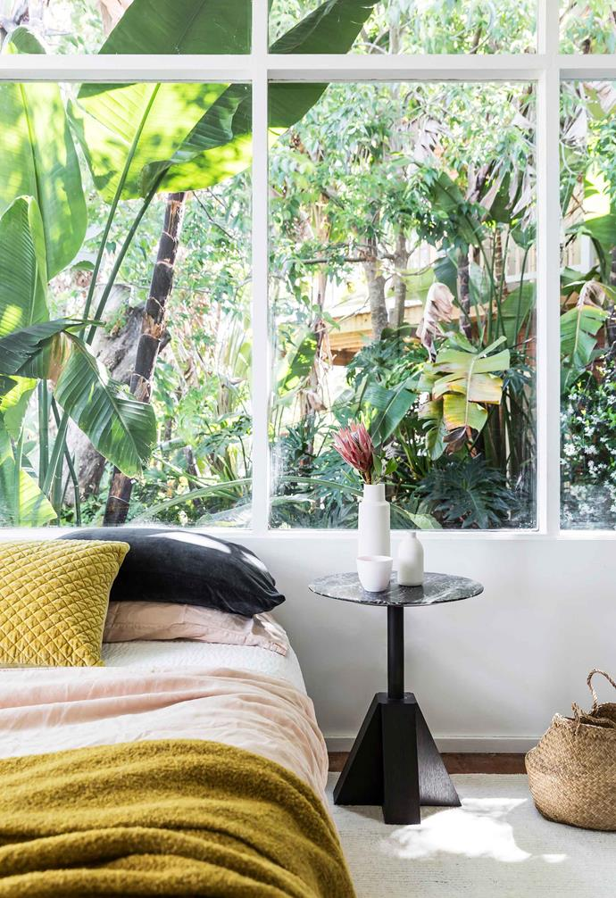 """**Bedroom** The leafy garden inspired the decor of this serene sleep space. Pink and mustard bed linen from [Jardan](https://www.jardan.com.au/
