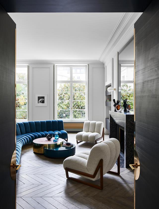 "This [glamorous yet family-focused apartment](https://www.homestolove.com.au/glamorous-paris-apartment-21006|target=""_blank"") epitomises the style of designers Humbert & Poyet with both classic and contemporary references. The 'Ava' floor lamp, the blue velvet sofa and the white armchairs are by the designers for The Invisible Collection and echo their ethos of ""luxury meant for everyday living"". ""We have designed statement pieces that evoke a sense of sophistication through an understated elegance,"" say the duo."