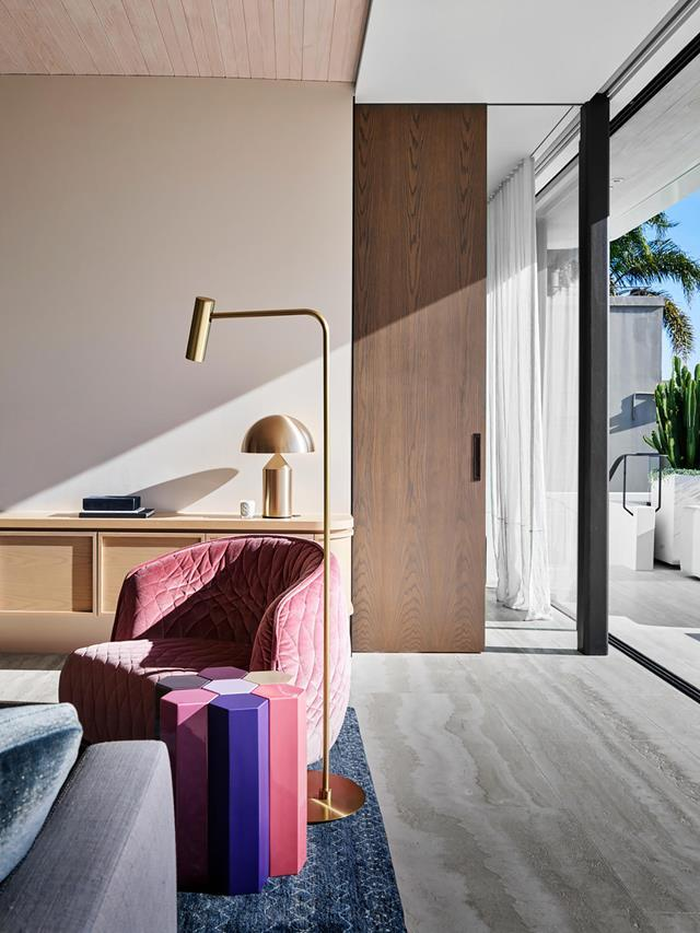 "With so much drama outside it is quite fitting that the interior design by Alexandra Donohoe Church, principal of Decus Interiors, is so considered and calm. This is a [house that whispers luxury](https://www.homestolove.com.au/elegant-family-home-with-show-stopping-views-20493|target=""_blank"") rather than shouts it. The family living area has a Moroso 'Redondo' armchair from Hub with Christophe Delcourt 'MUC7' side table from Ondene on a 'Morocco 3' rug from Robyn Cosgrove."