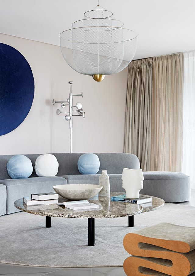 "Alicia Holgar reimagined this apartment into a [luxurious and impressive space](https://www.homestolove.com.au/luxurious-apartment-filled-with-art-20492|target=""_blank"") with a light and welcoming atmosphere. ""The space feels impressive but not in the way you would expect. Through pushing boundaries and utilising the element of surprise, the calm palette is enriched by a sculptural sophistication, which adds new layers of depth, light and shade,"" explains Alicia."