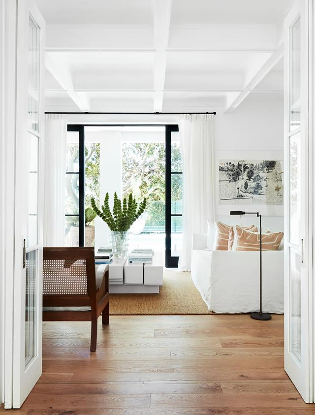 "Life is beautiful inside this [Mediterranean-inspired home](https://www.homestolove.com.au/historic-home-revamp-19835|target=""_blank"") where clever design by Melissa Marshall conjures a spirit of ease and generosity, just right for a growing family. The light-filled living area overlooks the pool and outdoor terrace and features a chair from Cotswold Furniture and an MCM House sofa."