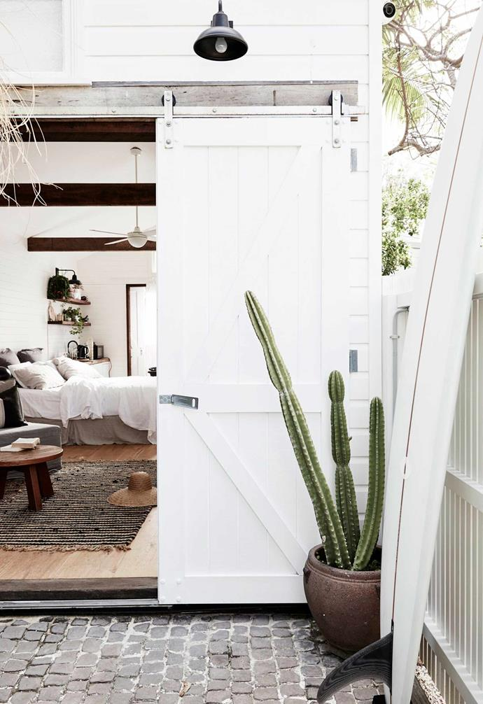 "When it comes to saving space, its important to pay attention to your [window and door styles](https://www.homestolove.com.au/window-and-door-styles-14811|target=""_blank""). Here, a rustic [barn door](https://www.homestolove.com.au/barn-door-17386