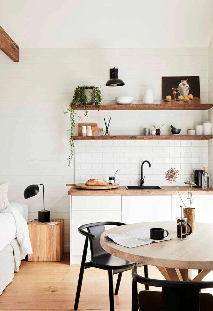 When it comes to creating a cosy home-like environment, its all in the details. The addition of a small artwork and pot plant to the shelf in this kitchenette adds a home-y touch.