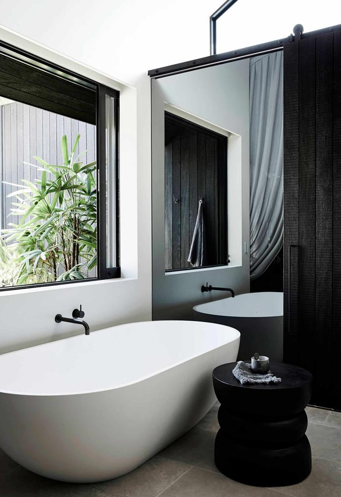 "When it comes to creating a bathroom with mass appeal, you can't go wrong with a [classic bathroom colour palette](https://www.homestolove.com.au/bathroom-colour-ideas-16119|target=""_blank""). In this space at The Bower an elegant [freestanding bathtub](https://www.homestolove.com.au/freestanding-baths-4520