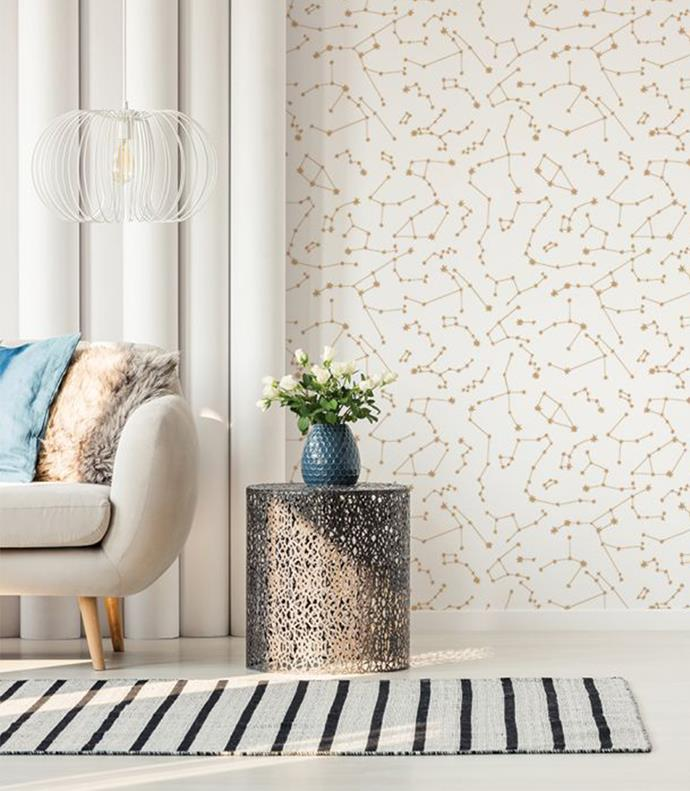 """'Constellations' wallpaper in Frost, [Tempaper](https://tempaper.com/constellations-white-gold-stars-removable-wallpaper