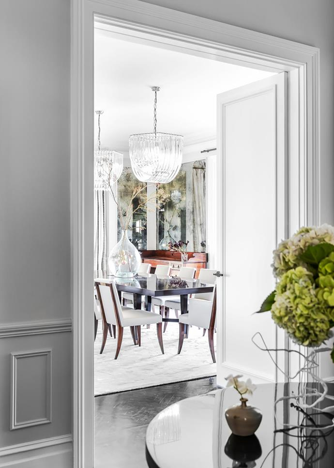 In the formal dining room a Baker 'Larchmont' table is attended by Baker 'Atelier' chairs, all from Studio Cavit. 'Windy' rug in Winter Moss from Robyn Cosgrove. 'Hyères' ceiling lamps from Regency Distribution. Custom mirrored panelling by Alexandra Kidd Design.