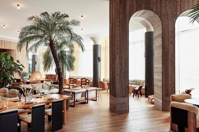 Transitional archways and carefully arranged furniture create intimate zones throughout the Palma lobby lounge.