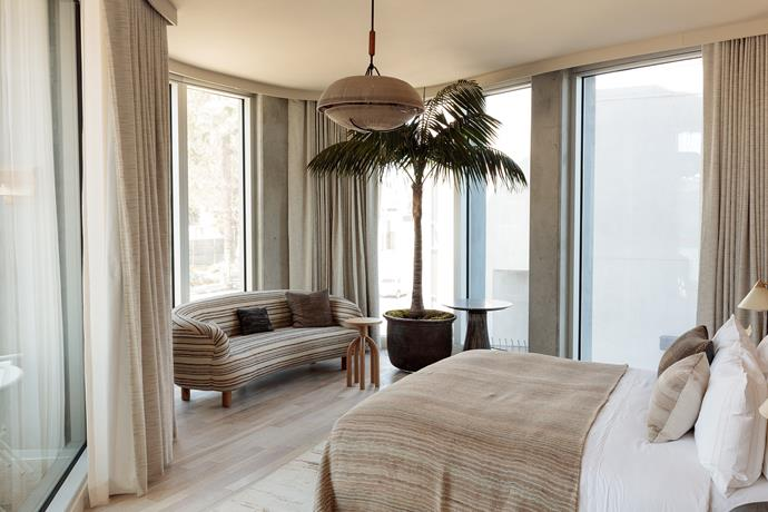 The Deluxe suites offer panoramic city views framed by electronic curtains, modern Scandinavian-designed furniture and travertine bathrooms.