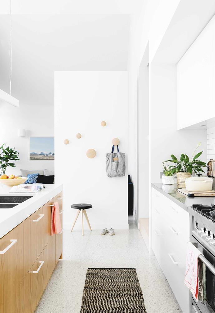 """""""It was just a box with a hallway down the centre and rooms off either side,"""" remembers Will. """"It wasn't until we'd lived in it for a while that we realised just how run-down it was.""""<BR><BR>**Kitchen** Polished aggregate floors and the Caesarstone-topped island are examples of the clean tones seen throughout the house. [Muuto](https://muuto.com/