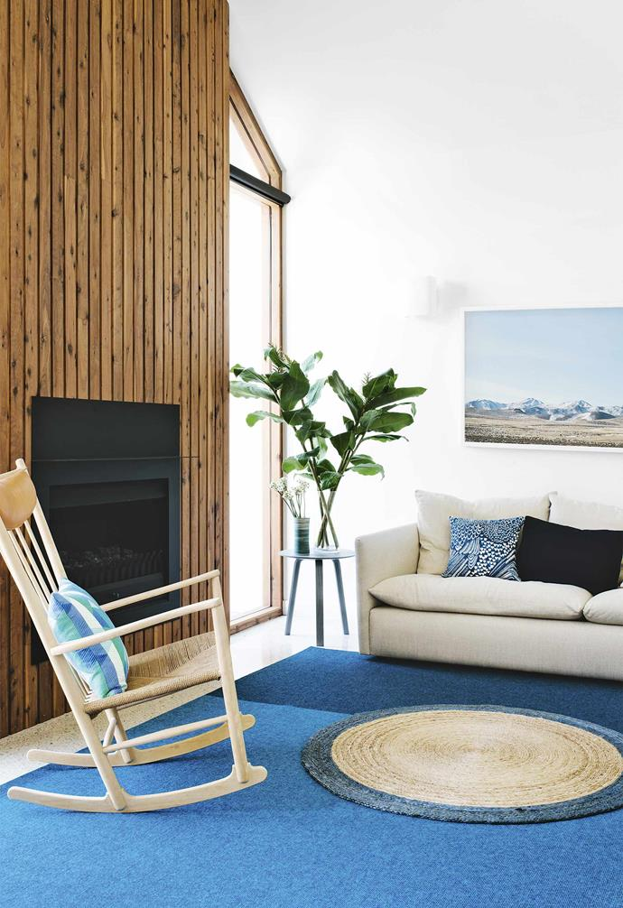 """The glass walls have doors at intervals instead of working as bi-folds. The cypress pine used in the framework is carried through to a [feature wall](https://www.homestolove.com.au/timber-feature-walls-13821