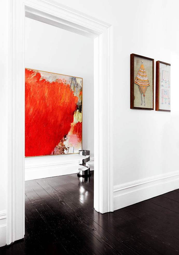 """While respecting its heritage and period features the owner of this [Sydney terrace](https://www.homestolove.com.au/luxury-home-tour-historical-sydney-terrace-3559 target=""""_blank"""") injected a subtly modern aesthetic. The Guy Maestri work in the hallway creates a striking contrast to the dark floorboards which are also offset by bright walls."""