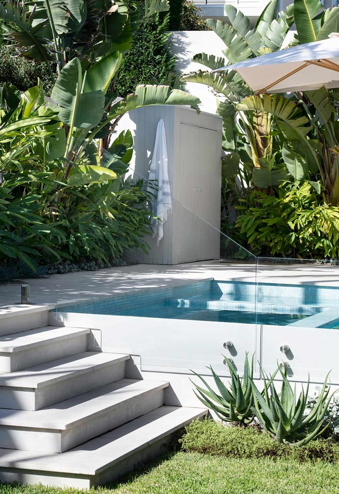 "It now rocks a luxe tropical look any self-respecting resort would be happy with, care of light limestone pavers and water-cooling aqua mosaic tiles by [Ezarri](https://www.ezarri.com/en|target=""_blank""