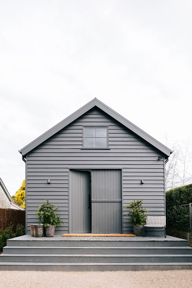 "This [small barn-style house in Daylesford](https://www.homestolove.com.au/small-barn-style-home-21098|target=""_blank"") follows a classic barn design, with a high-pitched ceiling, exposed beams and split ""Mr Ed-style"" doors. Four large windows from an old schoolhouse add authenticity to the new build and flood the space with light."