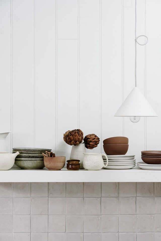 Display your ceramic collection on open shelving in your kitchen to add character and personal style to the space.