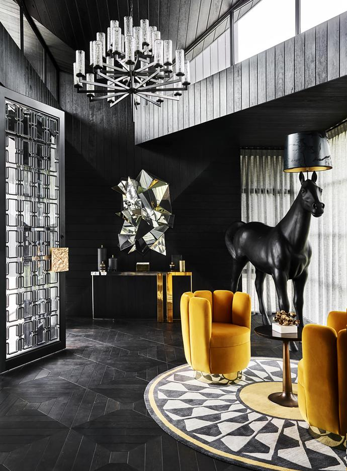 In the entry, 'Martini' side table from Holly Hunt. India Mahdavi 'Charlotte' armchairs from Ralph Pucci, US. Front for Moooi 'Horse' lamp from Space. Froissé #2 sculpture by Mathias Kiss from Galerie Armel Soyer, Paris. Eichholtz 'Belgo' console from Regency Distribution. Kelly Wearstler 'Liaison' chandelier from Visual Comfort.