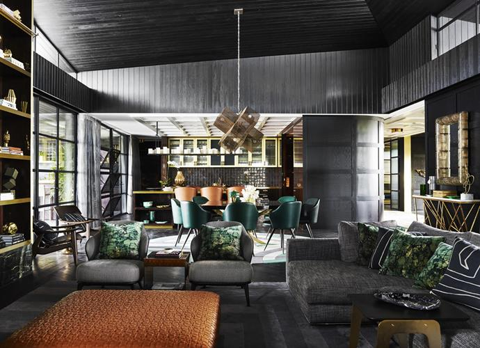 Minotti 'Hamilton' modular sofa, 'Leslie' armchairs and dining chairs, and 'Elliott' side table, all from De De Ce. Flexform 'Bangkok' ottoman from Fanuli. Jean-Louis Deniot 'Hastes' console from Jean de Merry. 'Perforated X' chandelier from Downtown, LA. Greg Natale custom rug from Designer Rugs.