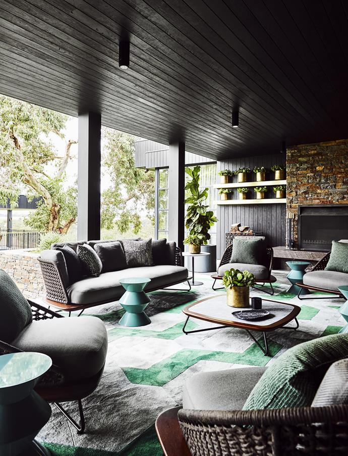 Minotti 'Cesar' side tables, 'Rivera' armchairs and coffee table, all from De De Ce. Brass pots from Garden Life. Perennials 'Hex Ed' rug.