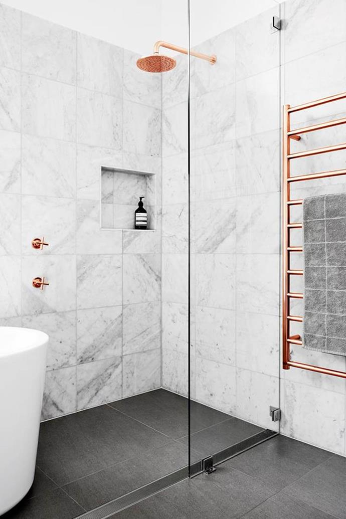 """Gleaming copper shines bright and warm in this elegant [marble bathroom](https://www.homestolove.com.au/a-luxe-copper-and-marble-bathroom-4680