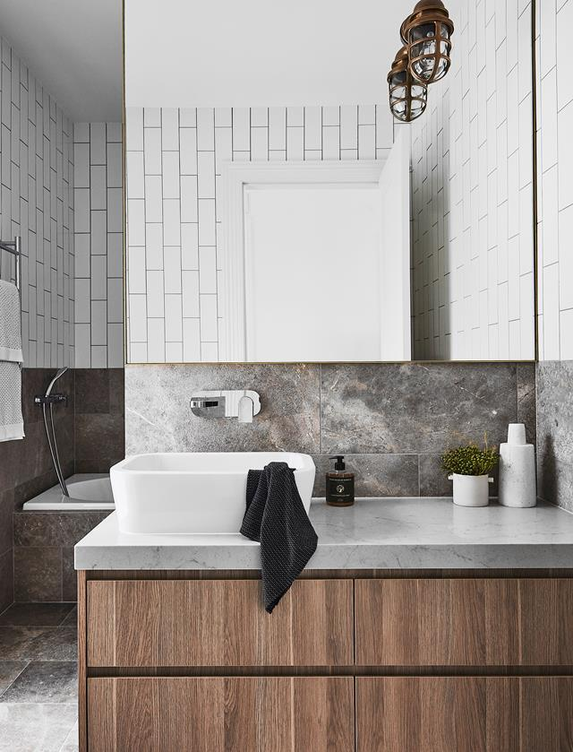 """Subway tiles have been laid vertically for interest in this [Hamptons-style home's](https://www.homestolove.com.au/cottage-turned-hamptons-style-home-20480