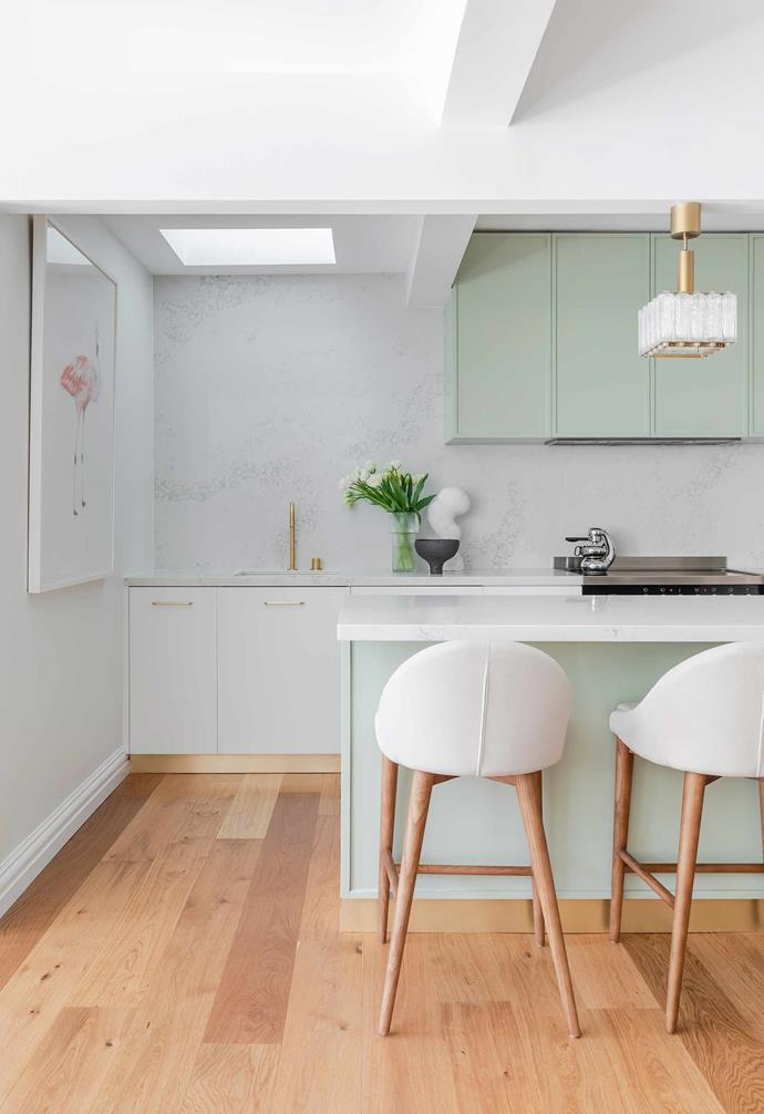 """**Kitchen** """"I love being in the kitchen and wouldn't change a thing about it"""", says interior designer Wanda Syzchowska, who lived with her family in this Sydney home for a number of years while renovating it. """"The cabinetry took eight colour samples to get right as I wanted a soft, muted, pale green that didn't overwhelm the space and tied in with the brass handles, kickboards, and stone benchtops."""""""