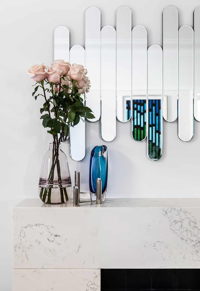 """**Living area** Designer Wanda Szychowska chose a retro mirror for the wall above her marble mantelpiece; the reflection is a custom artwork. Pink vase, [Freedom](https://www.freedom.com.au/