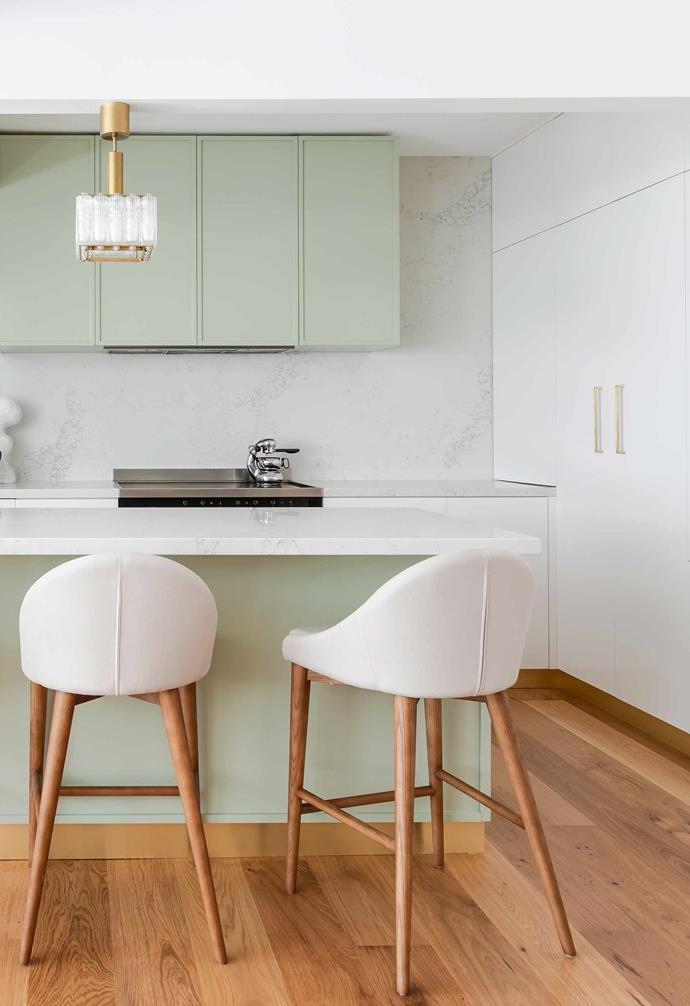 """**Kitchen** Two-pack polyurethane cabinets in white and green work with the cool Statuario Quartz benchtops and splashback. The warmer floor is European Oak with Castle character from [Havwoods](https://www.havwoods.com/au/