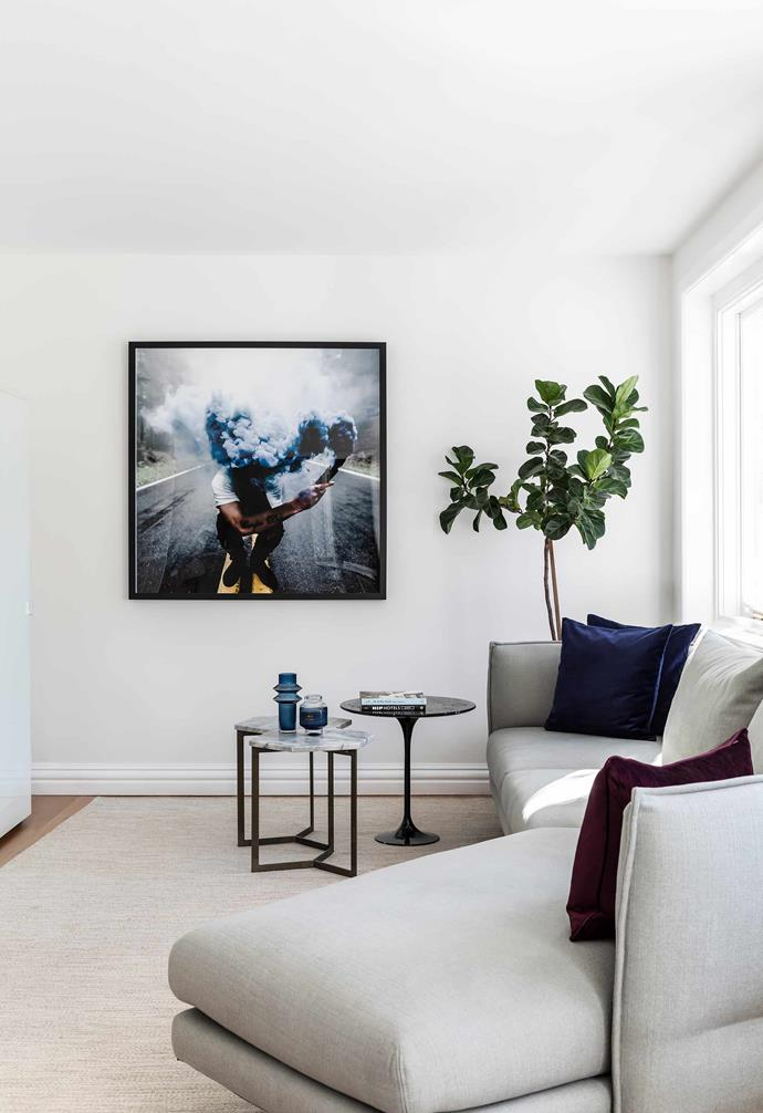 """**Living room** While all the home's furniture is fairly neutral, the 'noise' comes from artworks such as this dynamic Carpe Diem print by Brian Crippe, available through [The Cool Hunter](https://thecoolhunter.net/