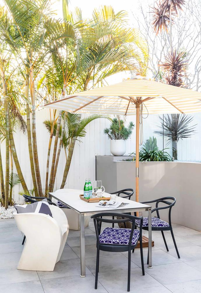 """**Terrace** This alfresco dining area is next to the pool. The table was custom made and the black chairs are from [Freedom](https://www.freedom.com.au/