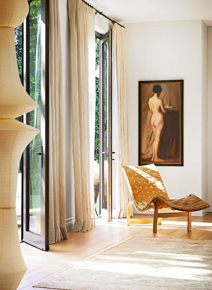 The undulating lines of a Noguchi lamp from Rewire, a Bruno Mathsson chair from Sumner Furniture and Holland & Sherry sheer linen curtain fabric create a moment of repose downstairs. The artwork is from Pat McGann Gallery and the rug is from Jamal's in LA. Both pieces are vintage.