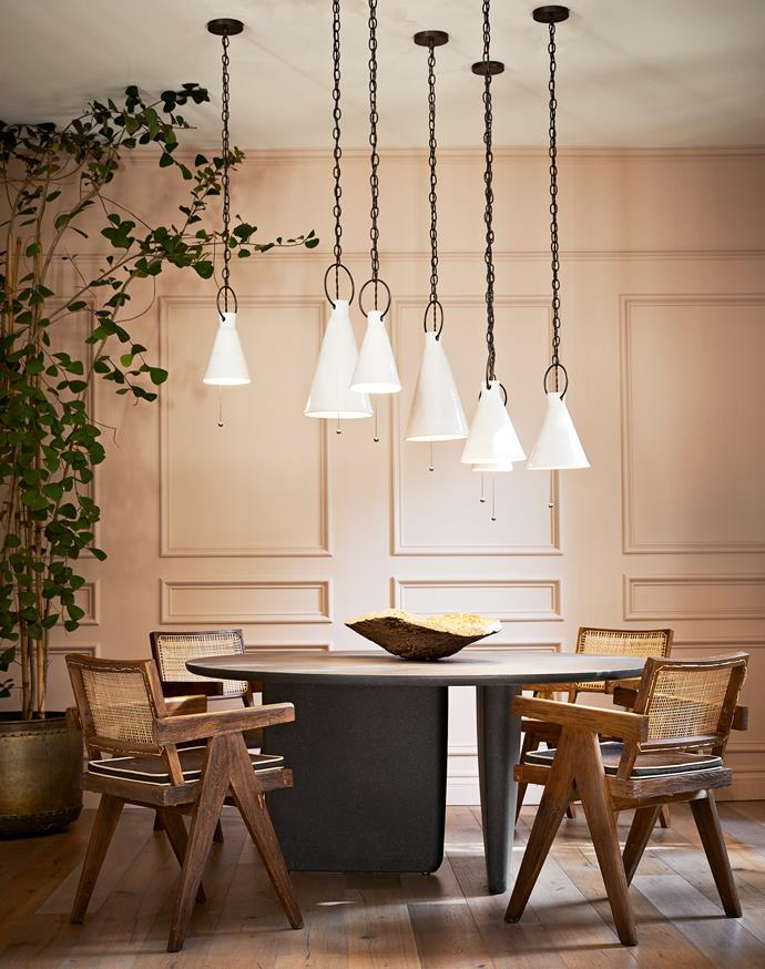 Designer Jase Sullivan and his client chose Portola Paints 'Angel's Landing' for the panelled dining room walls, which creates a sensual backdrop for the B&B Italia 'Tobi-Ishi' table from Diva, the Pierre Jeanneret chairs and Natalie Page ceramic pendant lights. A brass pot from The Window nurtures a towering triangle ficus plant.