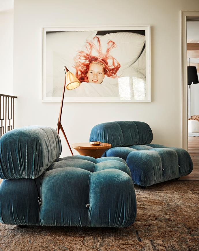 An original Juergen Teller photograph of Kate Moss takes pride of place in the upstairs landing. Sourced from ma+39, a pair of 'Camaleonda' chairs by Mario Bellini for B&B Italia make the most of this space. The floor lamp is a 1960s Swedish design by Uno and Östen Kristiansson. Vintage side table and rug.