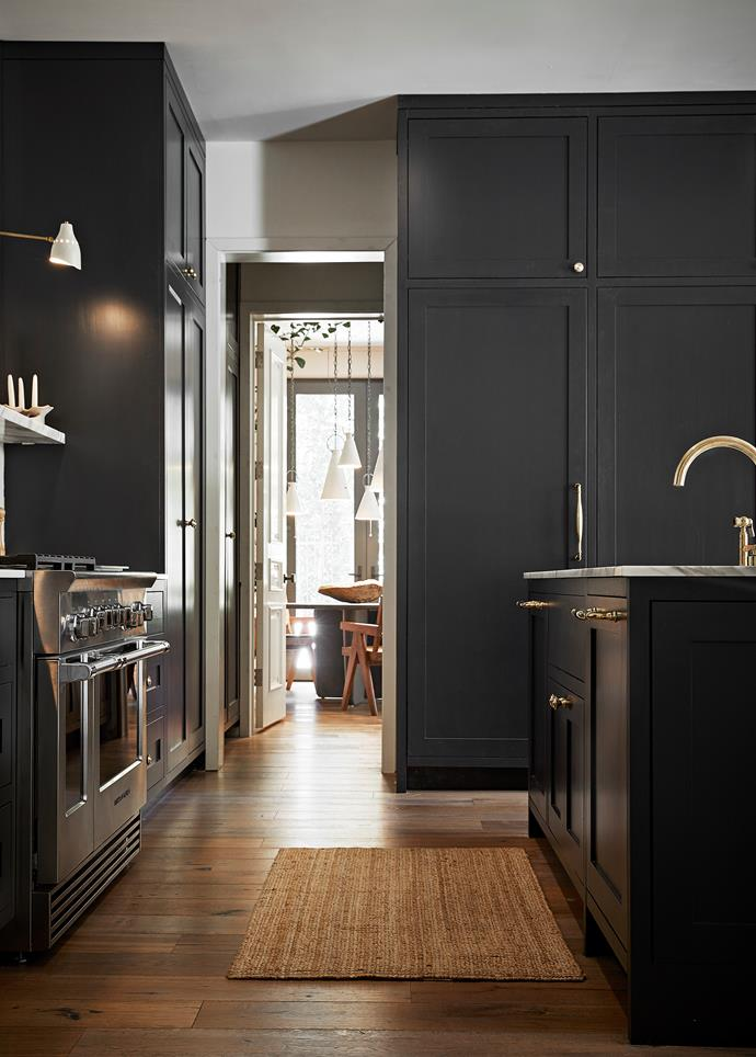 Kitchen cabinets custom designed by Jase. He selected unlacquered brass accessories, including Waterworks tapware and Renaissance Design Studio handles. Above the Fisher & Paykel oven is a 'LUread F' wall sconce from Lumfardo.