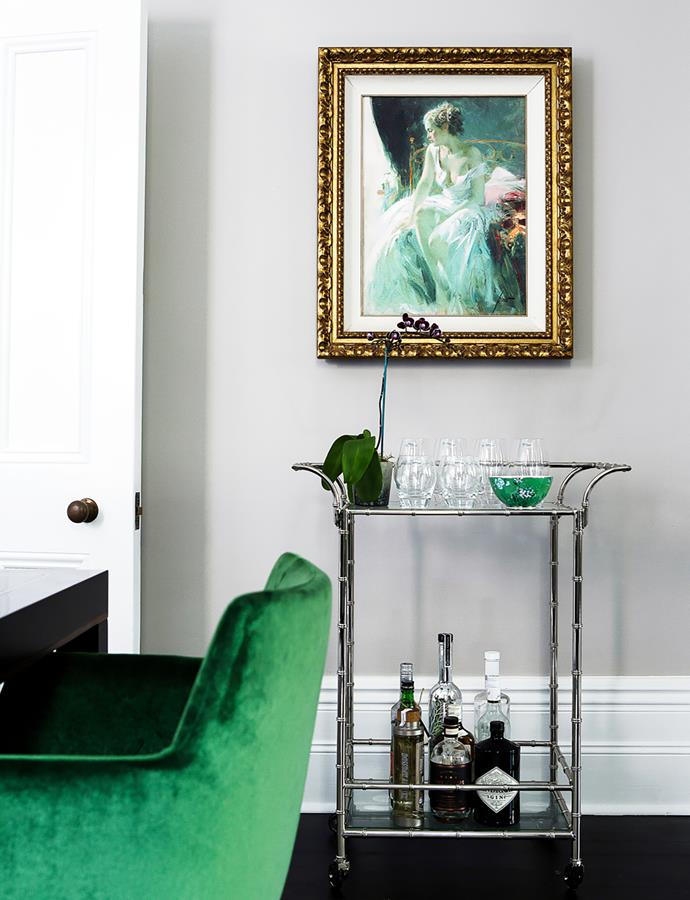 Pino Morning Breeze painting hangs above a vintage bar cart holding accessories by Jasper Conran.
